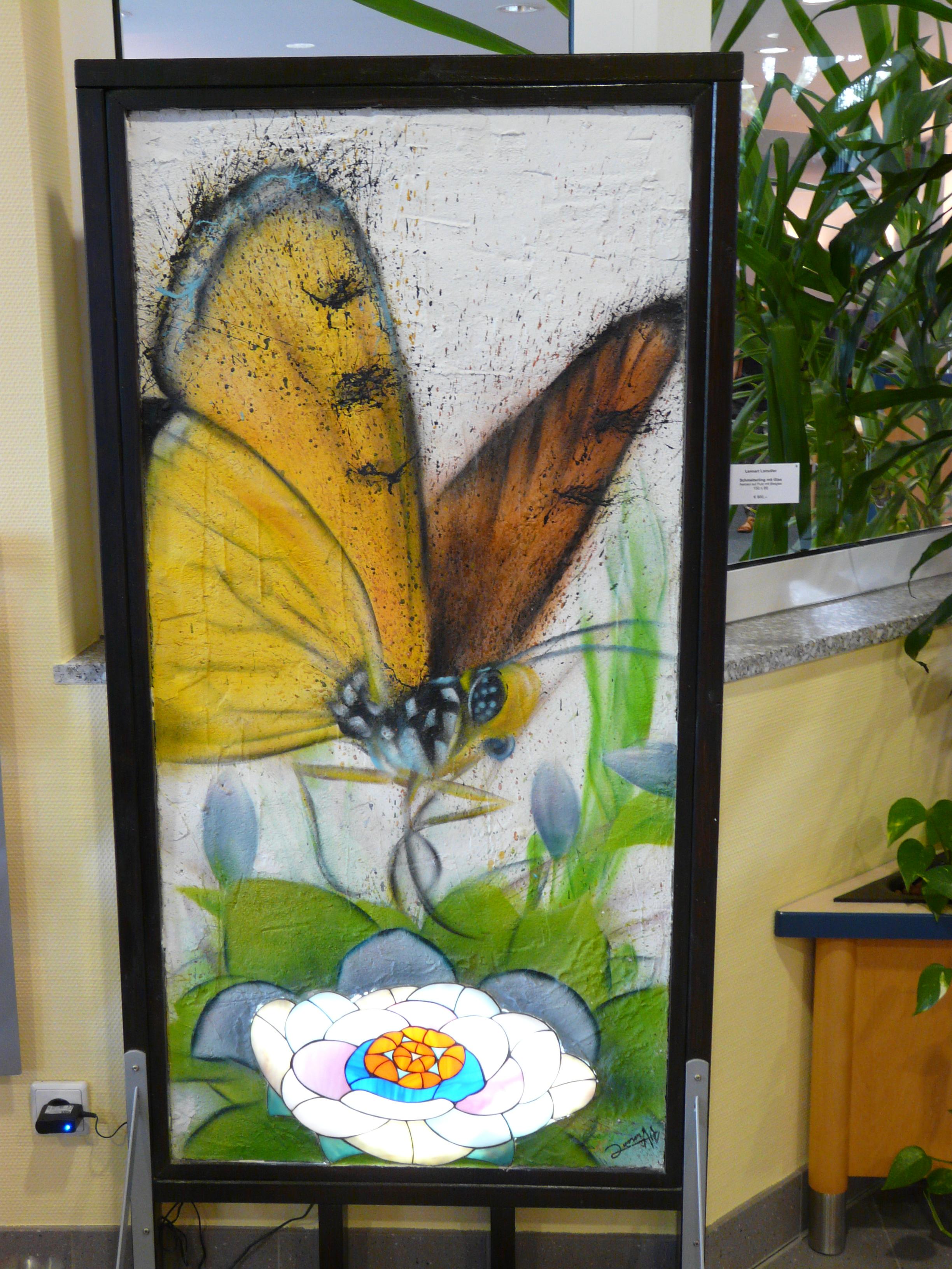 Schmetterling mit Glas