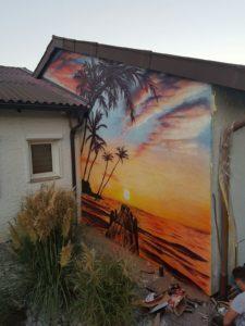 Graffitiauftrag Strand Sonnenuntergang